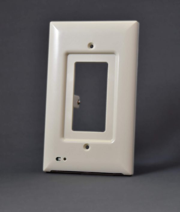 Almond colored decora outlet cover with built-in light